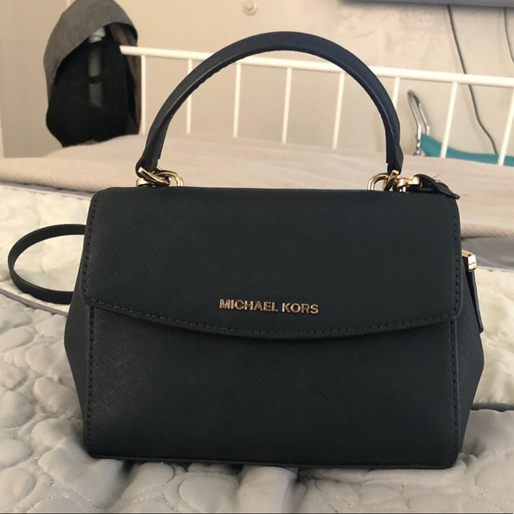 aaadb289a7ae Ava extra small Saffiano leather crossbody. M_5b05d94646aa7c95f7b9e698.  Other Bags you may like. Michael Kors Phone Crossbody
